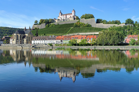 main river: View of the Marienberg Fortress reflecting in the Main River in Wurzburg, Germany