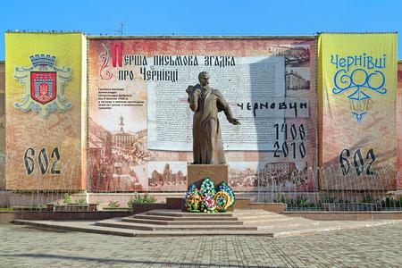 chernivtsi: Monument of Taras Shevchenko in Chernivtsi on the background of poster commemorating the 602nd anniversary of the first written mention of the city, Ukraine