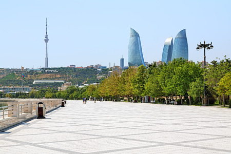 baku: View of the Flame Towers skyscrapers and TV tower from the embankment of Caspian Sea in Baku, Azerbaijan