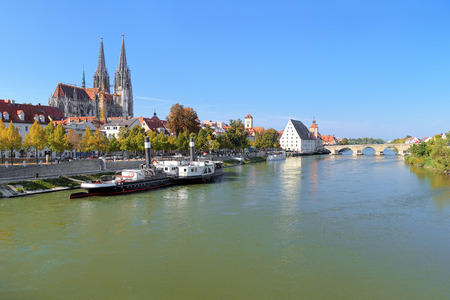 regensburg: View on Danube river in Regensburg with Regensburg Cathedral, Tower of Town Hall, Salt House and Stone Bridge, Germany