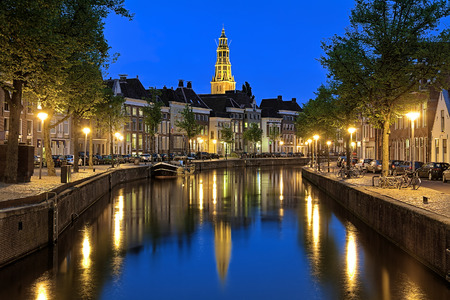green yellow: Evening view of the Aa river Drentsche Aa with tower of the AChurch AaKerk in Groningen Netherlands