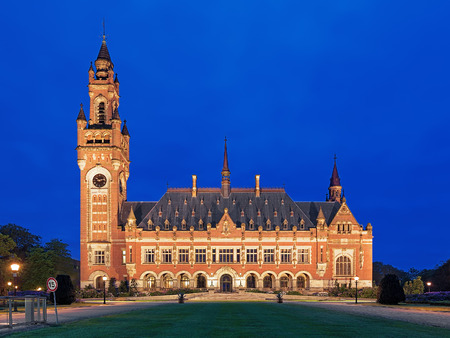 arbitration: The Peace Palace at evening in The Hague Netherlands. It houses the International Court of Justice of UN the Permanent Court of Arbitration and the Hague Academy of International Law.