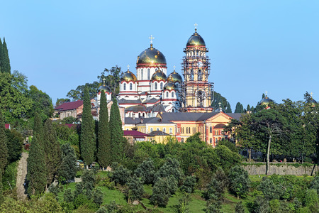 martyr: View of the New Athos Monastery Novy Afon Monastery with Cathedral of St. Panteleimon the Great Martyr and Belfry Abkhazia Stock Photo