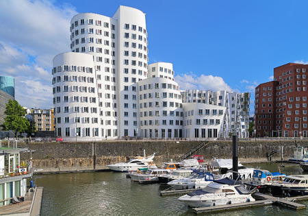 american media: Buldings of Neuer Zollhof in the Media Harbor of Dusseldorf, Germany. The Neuer Zollhof buildings was designed by the famous American architect Frank O. Gehry and completed in 1998. Editorial