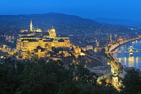 evening church: Budapest, Hungary. Buda Castle with Royal Palace and Matthias Church at evening, view from Gellert Hill.