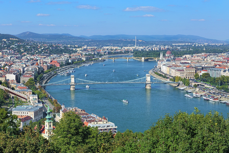 building a chain: View of Danube with Szechenyi Chain Bridge and Hungarian Parliament Building from Gellert Hill in Budapest, Hungary