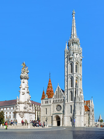 castle district: BUDAPEST, HUNGARY - OCTOBER 2, 2015: Matthias Church and Holy Trinity Column in Budas Castle District. The church was constructed in the florid late Gothic style in the second half of 14th century.