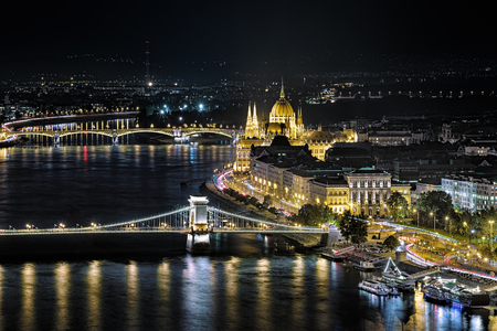 szechenyi: Budapest, Hungary. Night view of the Hungarian Parliament Building, Szechenyi Square former Roosevelt Square, Szechenyi Chain Bridge and Margaret Bridge over Danube. View from the Gellert Hill.