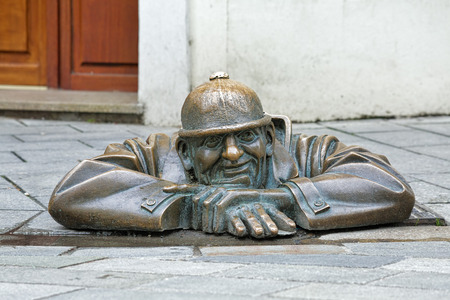 watcher: BRATISLAVA, SLOVAKIA - OCTOBER 11, 2015: Cumil the Peeper sculpture, also known as The Watcher or Man at Work. The sculpture by Viktor Hulik was unveiled on June 26, 1997 in the Old Town of Bratislava