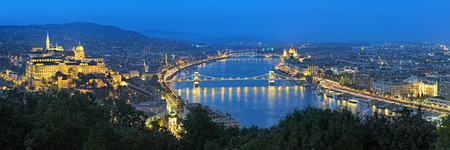 buda: Evening panorama of Budapest, view from Gellert Hill, Hungary. The panorama shows: Buda with Buda Castle, Danube river with Szechenyi Chain Bridge, Pest with Hungarian Parliament Building.