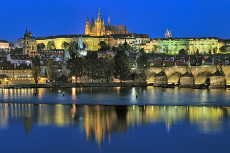 st nicholas cathedral: Prague, Czech Republic. Evening view of the Prague Castle with St. Vitus Cathedral, Castle district, Mala Strana district with St. Nicholas Church, and Charles Bridge with Mala Strana Bridge Towers.
