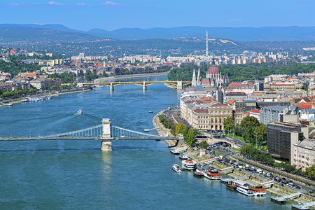 building a chain: Budapest, Hungary. View of Danube with Szechenyi Chain Bridge, Margaret Bridge and Hungarian Parliament Building. View from Gellert Hill. Stock Photo