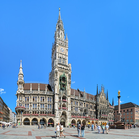 gothic revival: MUNICH, GERMANY - AUGUST 26, 2010: Panoramic view of Marienplatz with New City Hall and Marys Column. The New City Hall was built in 1867-1908 by Georg von Hauberrisser in a Gothic Revival style.