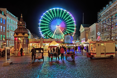weihnachtsmarkt: COPENHAGEN, DENMARK - DECEMBER 12, 2015: Christmas market with Ferris wheel on the Nytorv square in evening. On this market sells traditional Danish food, drinks and a wide range of winter clothing.
