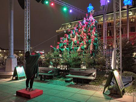 chorus: GOTHENBURG, SWEDEN - DECEMBER 16, 2015: Gothia Show Chorus sing Christmas song at Drottningtorget square. Tradition of Sjungande Julgranen Singing Christmas Tree exists in Gothenburg since 2003.