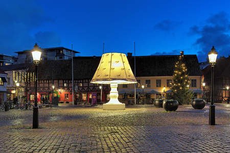 lilla: MALMO, SWEDEN - DECEMBER 13, 2015: Giant Lamp on Lilla Torg Square. Throughout the year the lamp with height of 5.8 m tours the various squares of Malmo, but before Christmas it returns to Lilla Torg. Editorial
