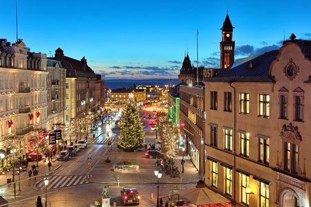 sund: HELSINGBORG, SWEDEN - DECEMBER 11, 2015: Evening view of Stortorget Square with Christmas Tree, Tower of the City Hall, Oresund strait and Danish coast. The square was built in 1693.