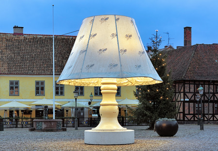 lilla: MALMO, SWEDEN - DECEMBER 15, 2015: Giant Lamp on Lilla Torg Square. Throughout the year the lamp with height of 5.8 m tours the various squares of Malmo, but before Christmas it returns to Lilla Torg.