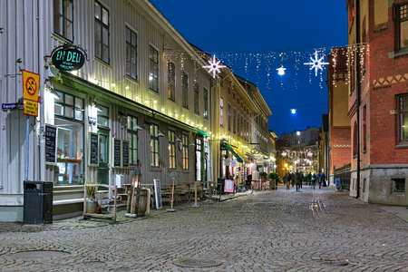 gothenburg: GOTHENBURG, SWEDEN - DECEMBER 16, 2015: Haga Nygata street with Christmas illuminations. The pedestrian street Haga Nygata is lined with well-preserved wooden houses of 19th century.