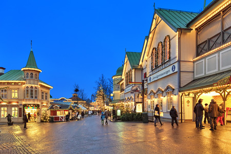 gothenburg: GOTHENBURG, SWEDEN - DECEMBER 17, 2015: Lisebergbanan station building with Christmas decoration in Liseberg amusement park. Liseberg amusement parks is the most famous Christmas Market of Sweden. Editorial