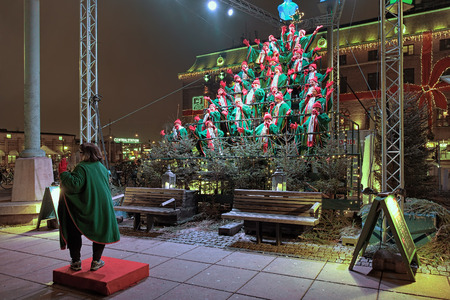 chorus: Gothia Show Chorus sing the ChGOTHENBURG, SWEDEN - DECEMBER 16, 2015: Gothia Show Chorus sing Christmas song at Drottningtorget square. Tradition of Sjungande Julgranen Singing Christmas Tree exists in Gothenburg since 2003.
