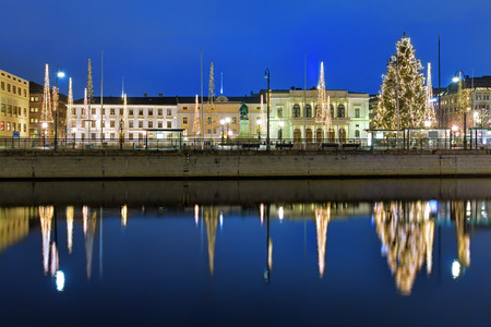 adolf: Gustaf Adolfs square in Gothenburg in the evening, decorated for Christmas and reflecting in the water of the main harbour canal, Sweden