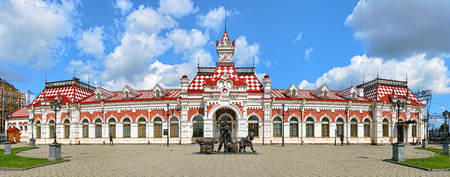 railway history: YEKATERINBURG, RUSSIA - JULY 20, 2015: Panorama of facade of the Old railway station building. The building was built in 1878, now this is the Museum of History of the Sverdlovsk Railroad.