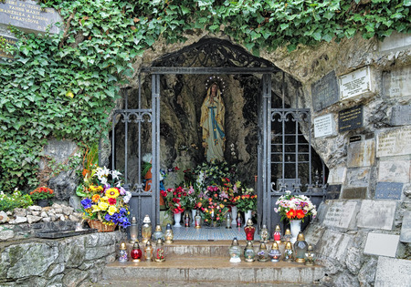 aureole: NITRA, SLOVAKIA - OCTOBER 9, 2015: Lourdes cave with statue of Virgin Mary. The cave, which serves as a chapel, located at the foot of the Calvary hill, the place of Calvary Christian pilgrimages.