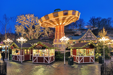 gothenburg: GOTHENBURG, SWEDEN - DECEMBER 17, 2015: Christmas Market with Carousel in the Liseberg park. It is one of the most visited amusement parks in Scandinavia and the most famous Christmas Market of Sweden