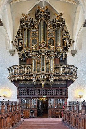 pipe organ: KRISTIANSTAD, SWEDEN - DECEMBER 11, 2015: Pipe organ of the Church of Holy Trinity Heliga Trefaldighets kyrka. The organ was made in 1630 by the German-Danish organ builder Johan Lorentz the elder.