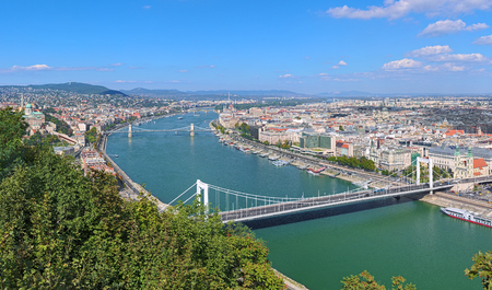 szechenyi: View of Budapest from Gellert Hill, Hungary. The image shows: Buda Castle, Danube with Elisabeth Bridge, Szechenyi Bridge and Margaret Bridge, Hungarian Parliament Building and St. Stephens Basilica.