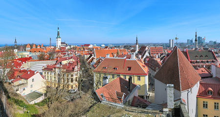 in low spirits: Tallinn, Estonia. Panoramic view from Kohtuotsa viewing platform on the Lower Town with Transfiguration Cathedral, Towers of City Wall, St. Olafs Church, Holy Ghost Church and Tower of City Hall. Stock Photo
