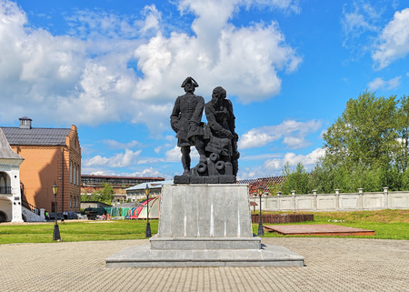 industrialist: NEVYANSK, RUSSIA - JULY 24, 2015: Peter the Great and Nikita Demidov Monument. The monument by sculptor Konstantin Grunberg was unveiled on July 19, 2002 near the famous Leaning Tower of Nevyansk. Editorial