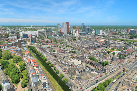 42nd: High angle view of The Hague downtown with skyscrapers from the panoramic terrace on the 42nd floor of Het Strijkijzer skyscraper, Netherlands