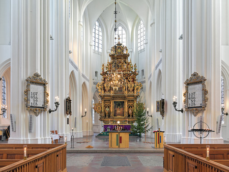 largest tree: MALMO, SWEDEN - DECEMBER 13, 2015: Chancel and altar of St. Peters Church (Sankt Petri kyrka). The altar, which was completed in 1611, is the largest wooden altar in northern Europe.