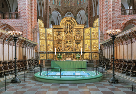 high altar: ROSKILDE, DENMARK - DECEMBER 14, 2015: High altar of Roskilde Cathedral. Since the Protestant Reformation in 16th century all Danish kings and almost all queens have been buried in Roskilde Cathedral. Editorial