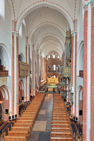 almost all: ROSKILDE, DENMARK - DECEMBER 14, 2015: Interior of Roskilde Cathedral. Since the Protestant Reformation in 16th century all Danish kings and almost all queens have been buried in Roskilde Cathedral.