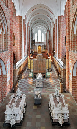high altar: ROSKILDE, DENMARK - DECEMBER 14, 2015: Interior of Roskilde Cathedral. Behind the high altar is situated the sarcophagi of Queen Margaret I, Duke Christopher, King Frederick IV and his wife Louise.