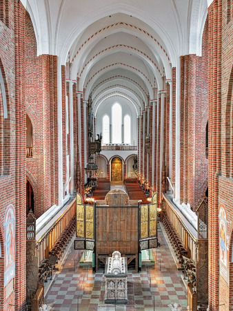 high altar: ROSKILDE, DENMARK - DECEMBER 14, 2015: Interior of Roskilde Cathedral. Behind the high altar is situated the sarcophagus of Queen Margaret I, made by the Lubeck sculptor Johannes Junge in 1423. Editorial