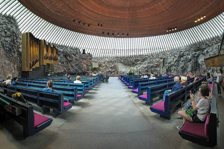 HELSINKI, FINLAND - JULY 21, 2016: Interior of the Temppeliaukio Church, also known as the Church of the Rock and Rock Church. The church was designed by Timo and Tuomo Suomalainen and opened in 1969.