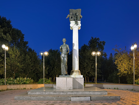 nikolay: TOMSK, RUSSIA - AUGUST 12, 2016: Monument to the Students of Tomsk or Monument to Saint Tatiana in the evening. The monument by sculptors Nikolay and Anton Gnedykh was erected in August 2004. Editorial
