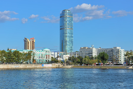rotunda: YEKATERINBURG, RUSSIA - AUGUST 19, 2016: View of Vysotsky skyscraper (188.3 m in height), business center Antey (76 m in height), Sevastyanov house in Russian gothic style, and Dam of the city pond.