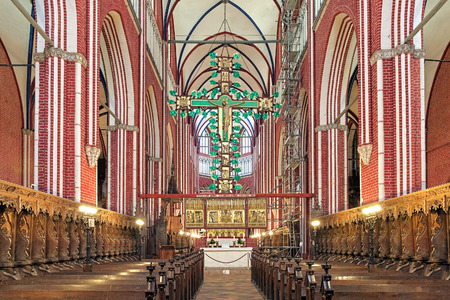 BAD DOBERAN, GERMANY - OCTOBER 22, 2016: Cross altar with 15-meter high triumphal cross in Doberan Minster. The altar was created in 1360-1370; it is the most monumental of its kind in Europe.