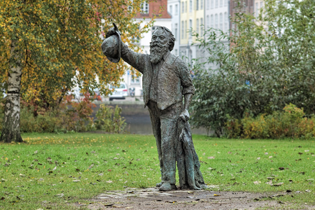 LUBECK, GERMANY - OCTOBER 19, 2016: Johannes Brahms Statue. The statue by Claus Goertz was erected in May 2012 on a shore of Trave River opposite the Academy of Music, seat of the Brahms Institute. Editorial