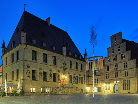 Osnabruck, Germany. Evening view of Market Square with Old Town Hall, Weigh House and erected Maypole