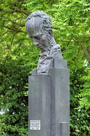 Bust of the German dramatist Christian Dietrich Grabbe in the Hofgarten park of Dusseldorf, Germany. The bust was made by the German sculptor Ernst Gottschalk in 1930. Editorial