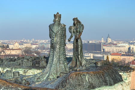 BUDAPEST, HUNGARY - DECEMBER 7, 2016: Sculpture of Prince Buda and Princess Pest, also known as Buda meets Pest, on the background of the city. The sculpture by Martha Lesenyei was unveiled in 1982. Editorial
