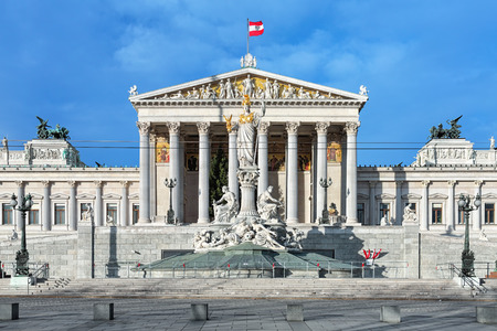 Austrian Parliament Building and Pallas Athene Fountain in Vienna, Austria. The building was completed in 1883. The fountain was erected between 1893 and 1902.
