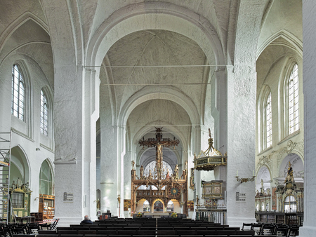 LUBECK, GERMANY - OCTOBER 20, 2016: Interior of Lubeck Cathedral. The cathedral was started in 1173 and consecrated in 1247. The 17-meter-high triumphal cross was made by Bernt Notke in 1470-1478. Editorial