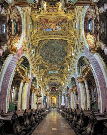 VIENNA, AUSTRIA - DECEMBER 9, 2016: Vertical panorama of the interior of Jesuit Church. Also known as the University Church, it was built in 1623-1627 and was remodeled by Andrea Pozzo in 1703-1705. Editorial